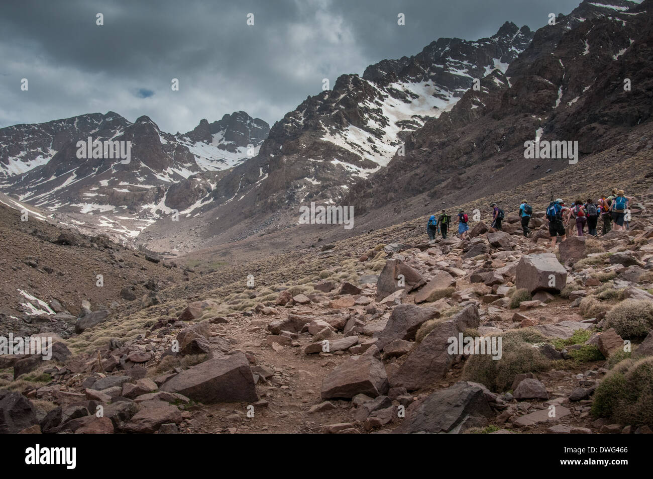 A group of trekkers approaching the Refuge du Toubkal in Morocco - Stock Image