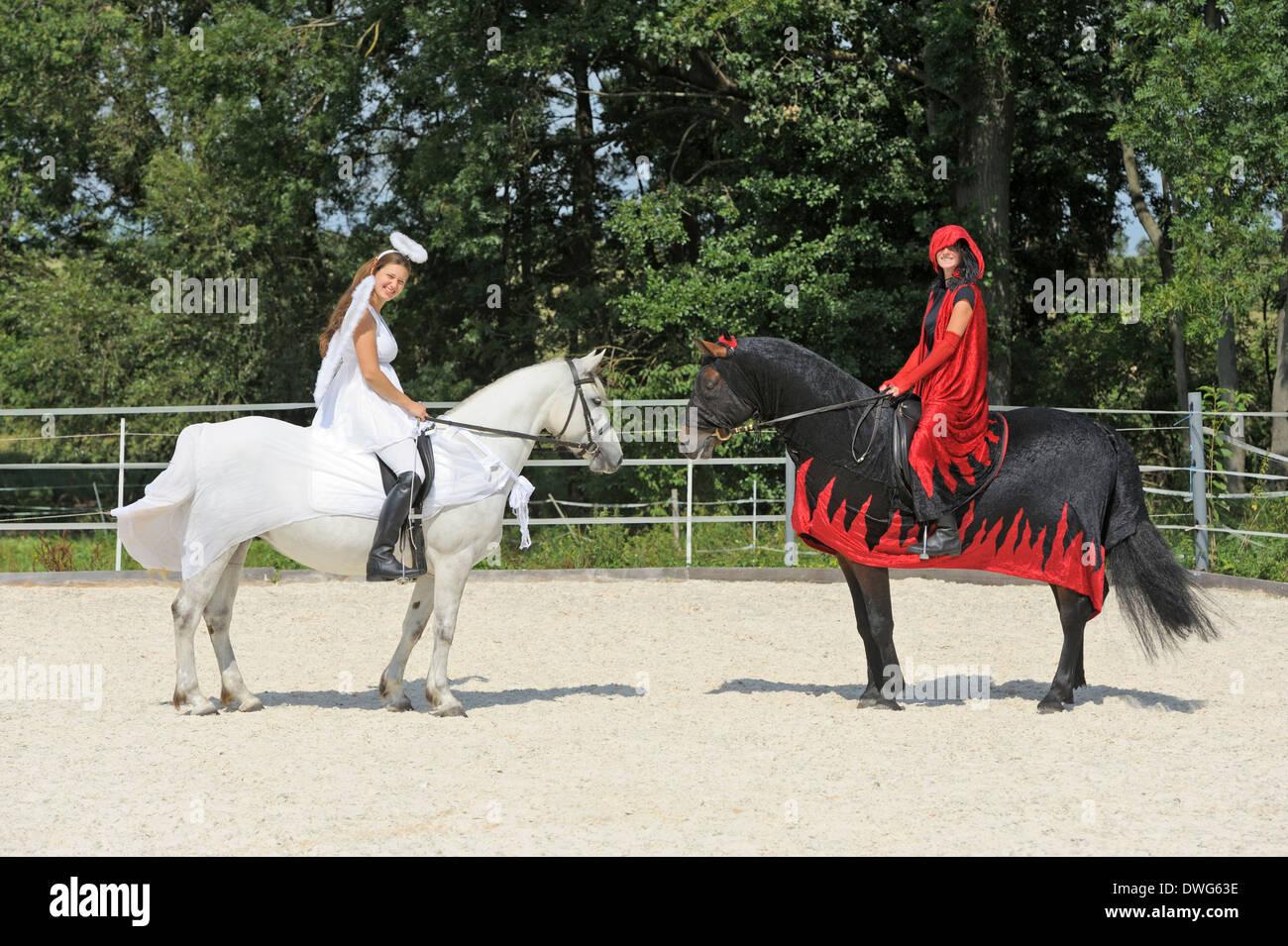 Riding Pas De Deux Angel And Devil Connemara Pony Mare And Stock Photo Alamy