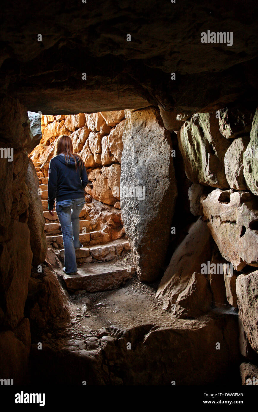 Coming out of the tunnel of the underground cistern in Ancient Mycenae ('Mykines'), Argolis (Argolida), Peloponnese, Greece. - Stock Image