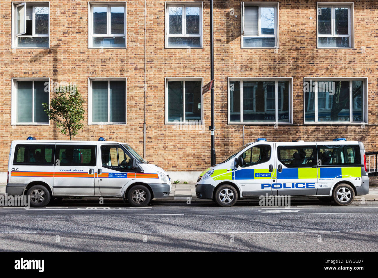 Two Metropolitan Police cars parked in Kennington road, Southwark, South London, SE1 - Stock Image