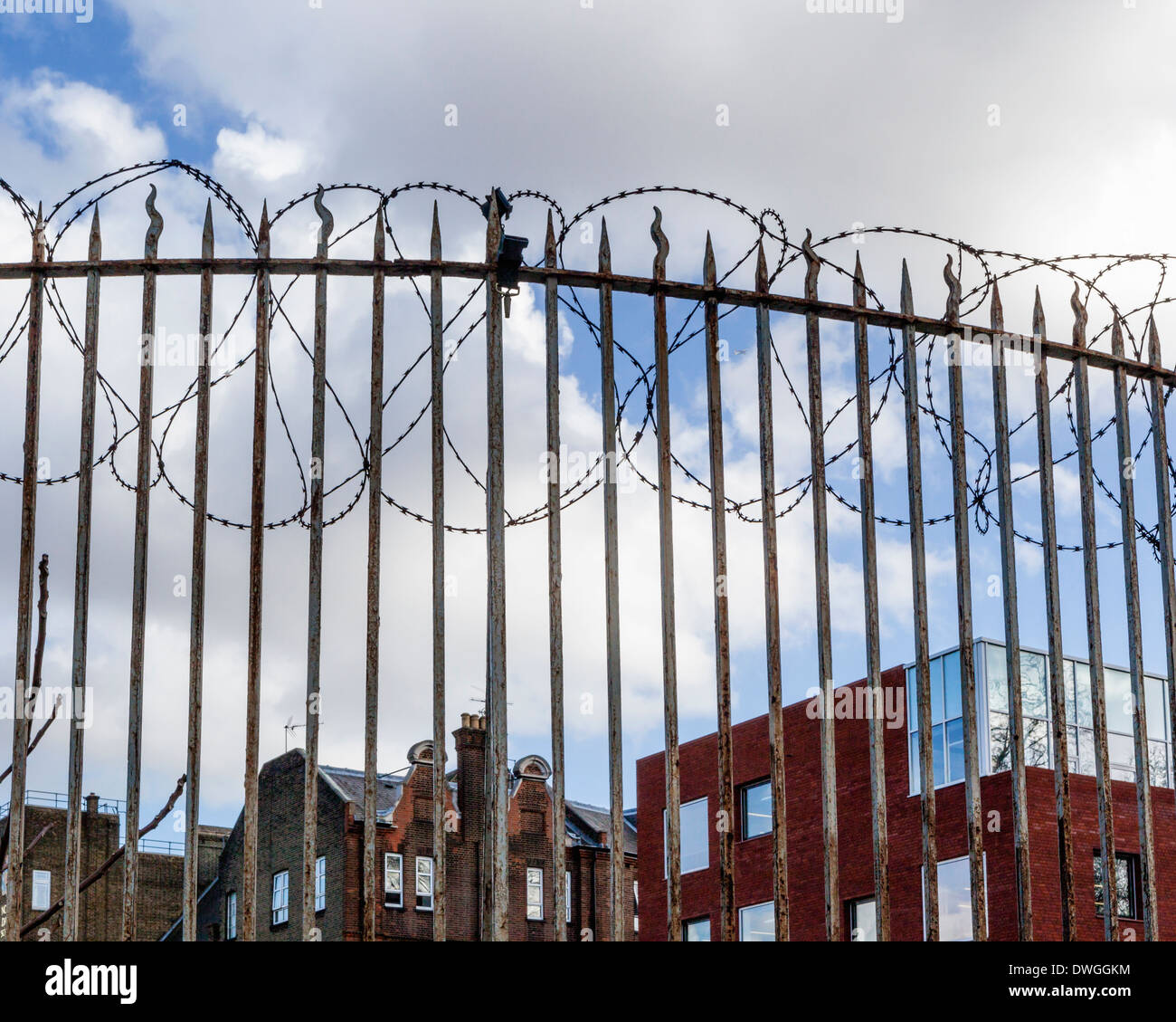 Buildings behind barbed wire and security fence in St George's Road, South London - Stock Image
