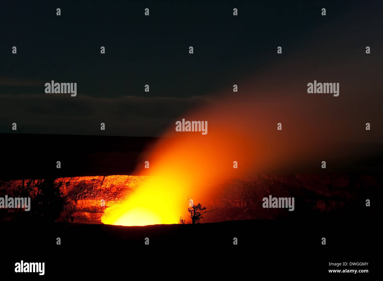 Smoking Crater of Halemaumau Kilauea Volcano in Hawaii Volcanoes National Park on Big Island at night - Stock Image