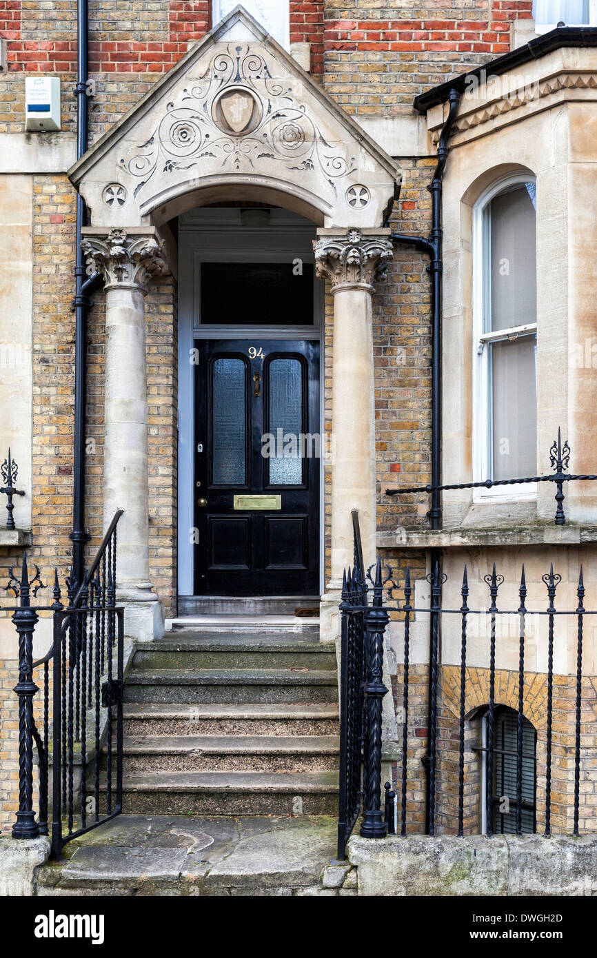 Decorative stone arch and columns of house entrance in Lambeth Road, Southwark, South London, SE1 - Stock Image