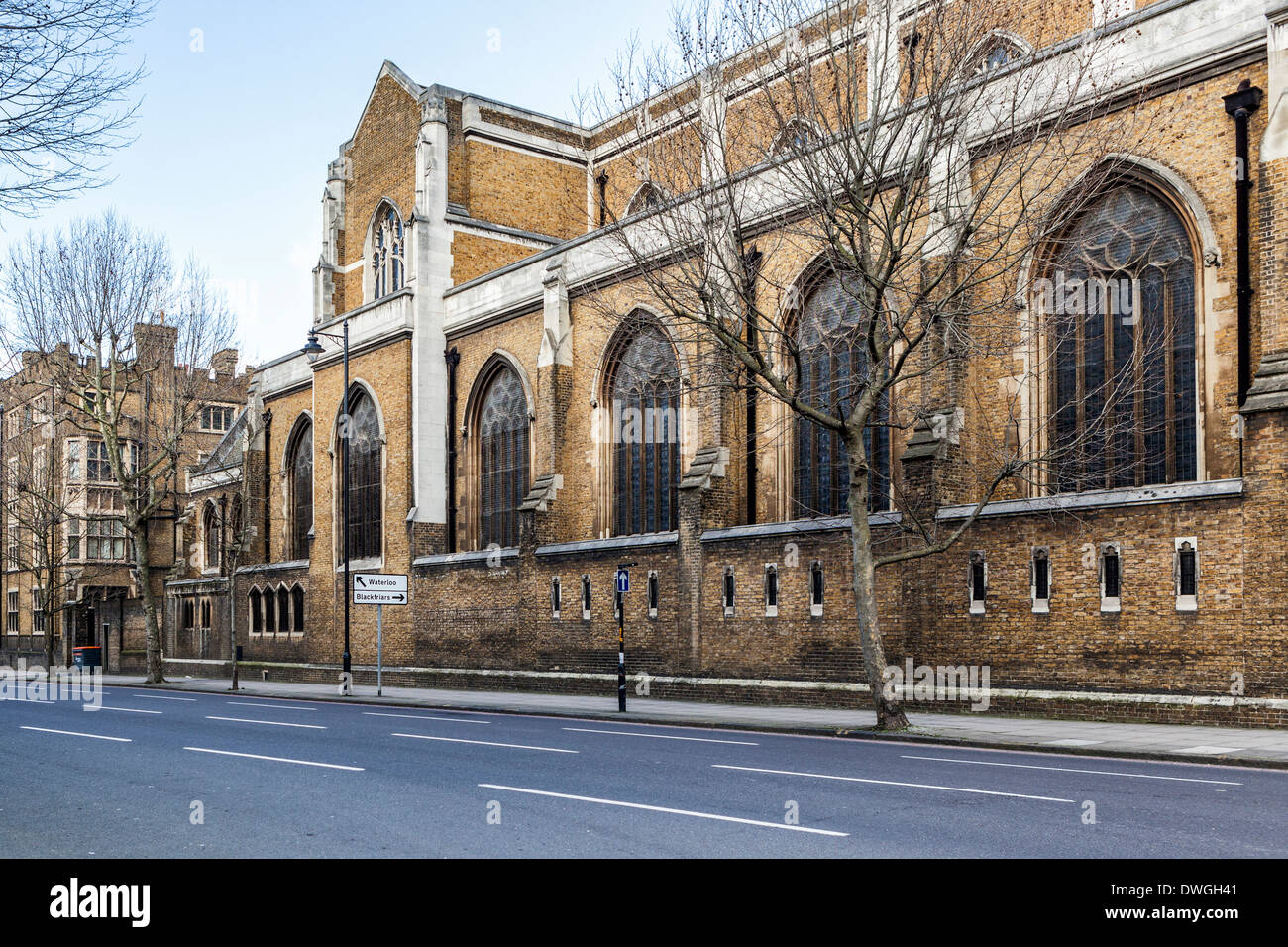 Arched windows and brick and stone exterior of St George's Cathedral - Roman Catholic church designed by Augustus Pugin, London - Stock Image