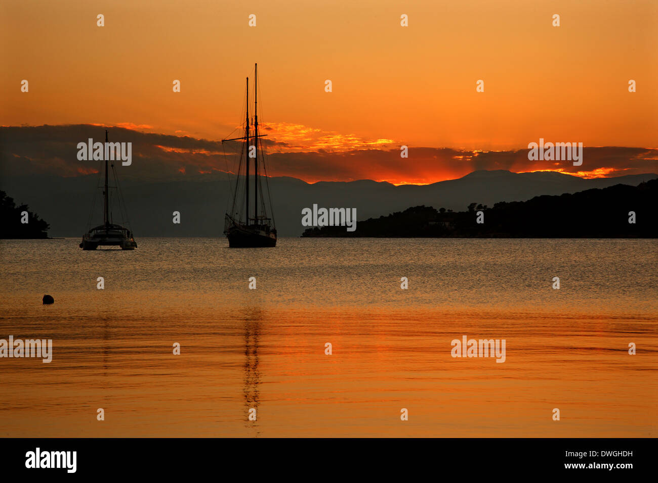 Sunset in Porto Heli (or 'Portoheli' or 'Porto Cheli'), Ermionida municipality, Argolida ('Argolis'), Peloponnese, Greece, - Stock Image