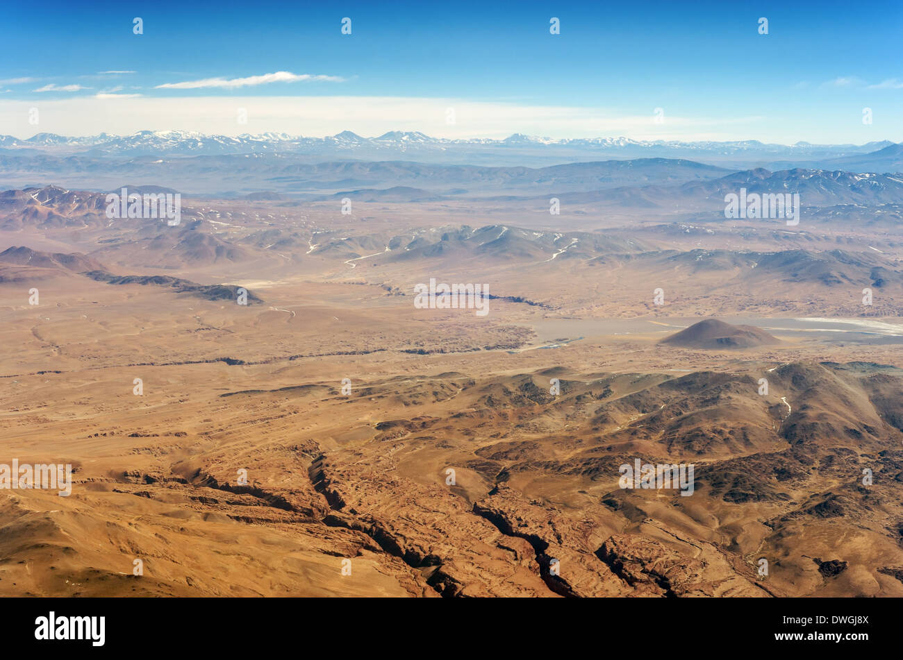 Aerial view of dry desert and the Andes Mountains somewhere over South America - Stock Image