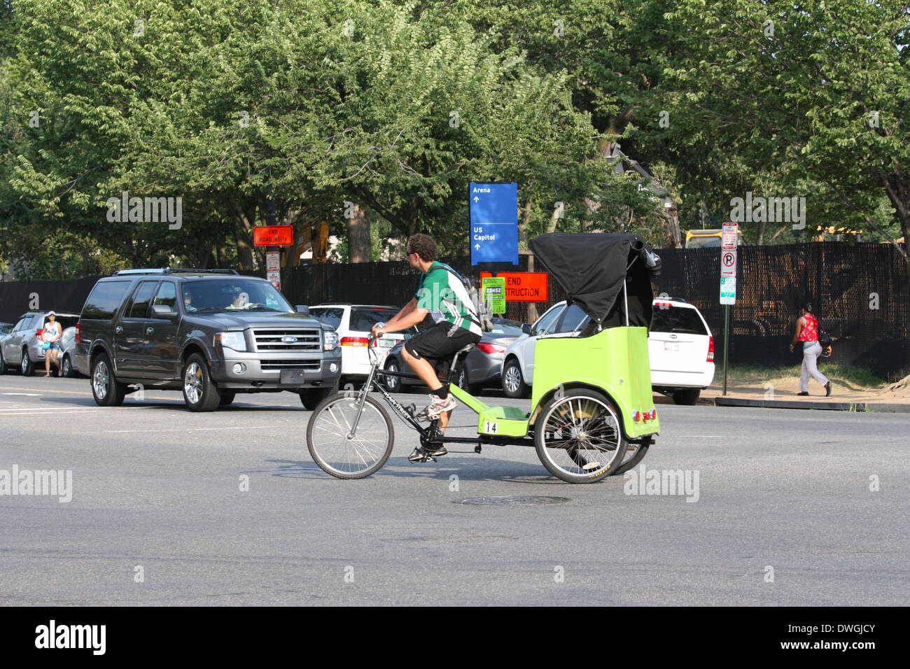 Man riding tricycle on the street in Washington DC Stock Photo
