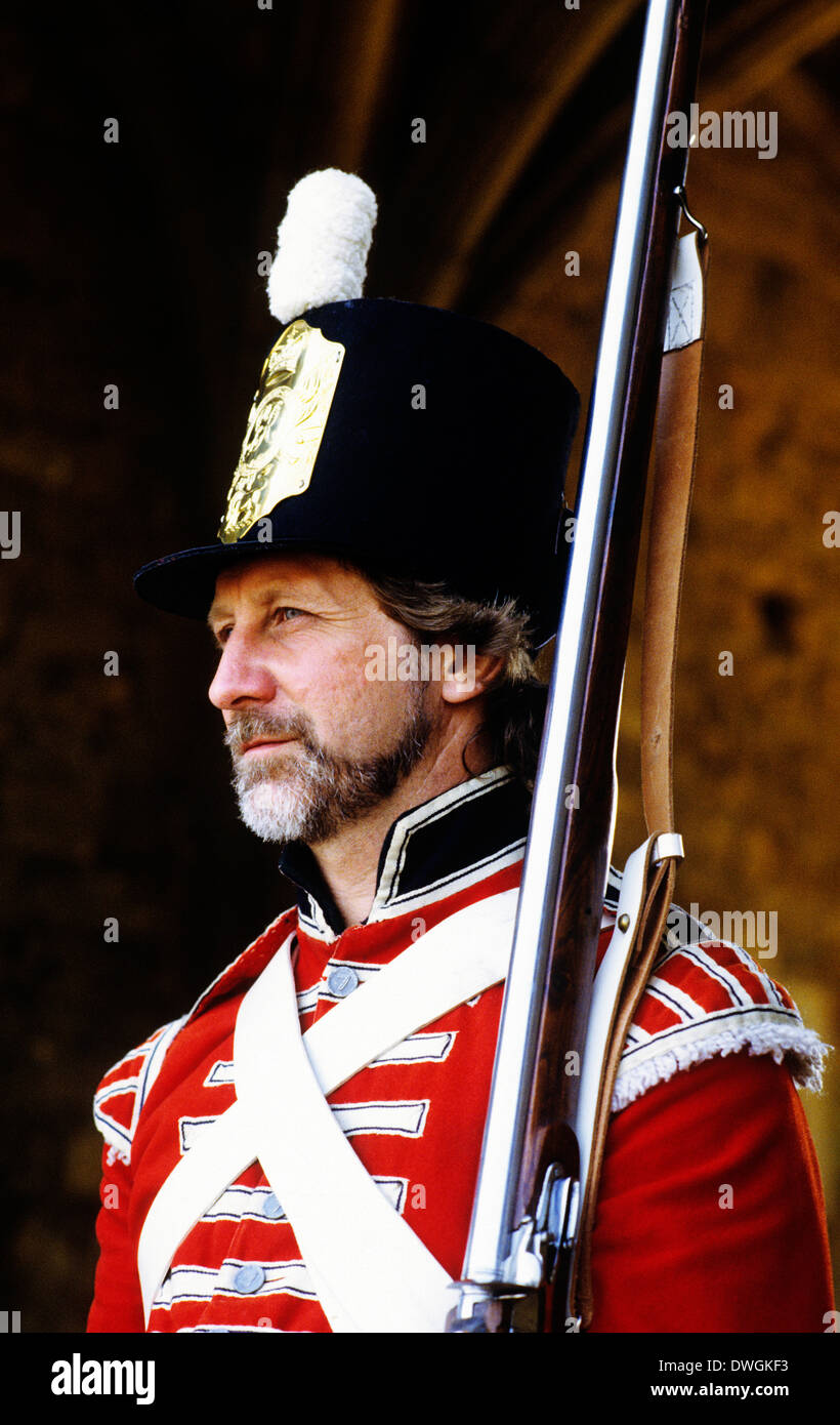 British redcoat rifleman, 1815, Napoleonic Wars, historical re-enactment soldier soldiers as deployed at Battle of Waterloo, uniform uniforms musket muskets England UK - Stock Image