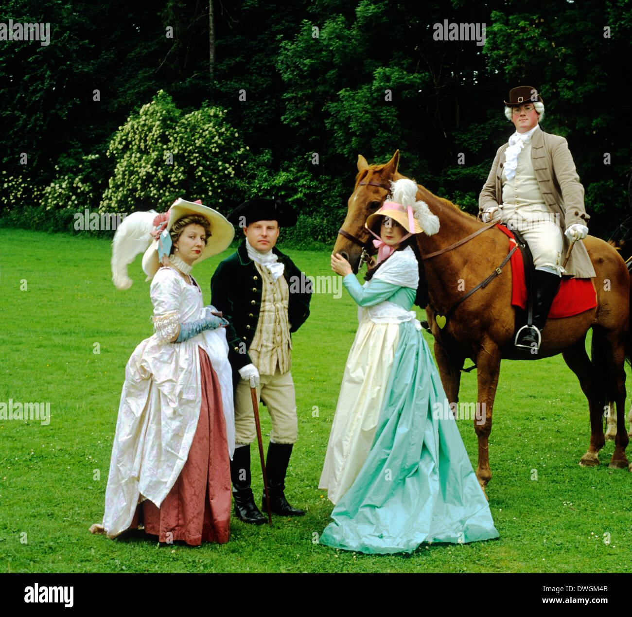 English 18th century Gentry c.1780 in parkland, Wrest Park Bedfordshire, historical re-enactment ladies gentlemen horse costume costumes dress fashion fashions England UK - Stock Image