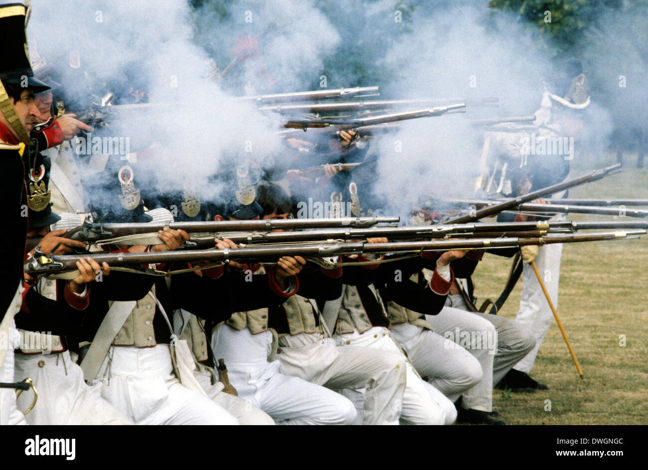 French Napoleonic riflemen soldiers firing muskets in battle, 1815, as deployed at Battle of Waterloo, historical re-enactment - Stock Image