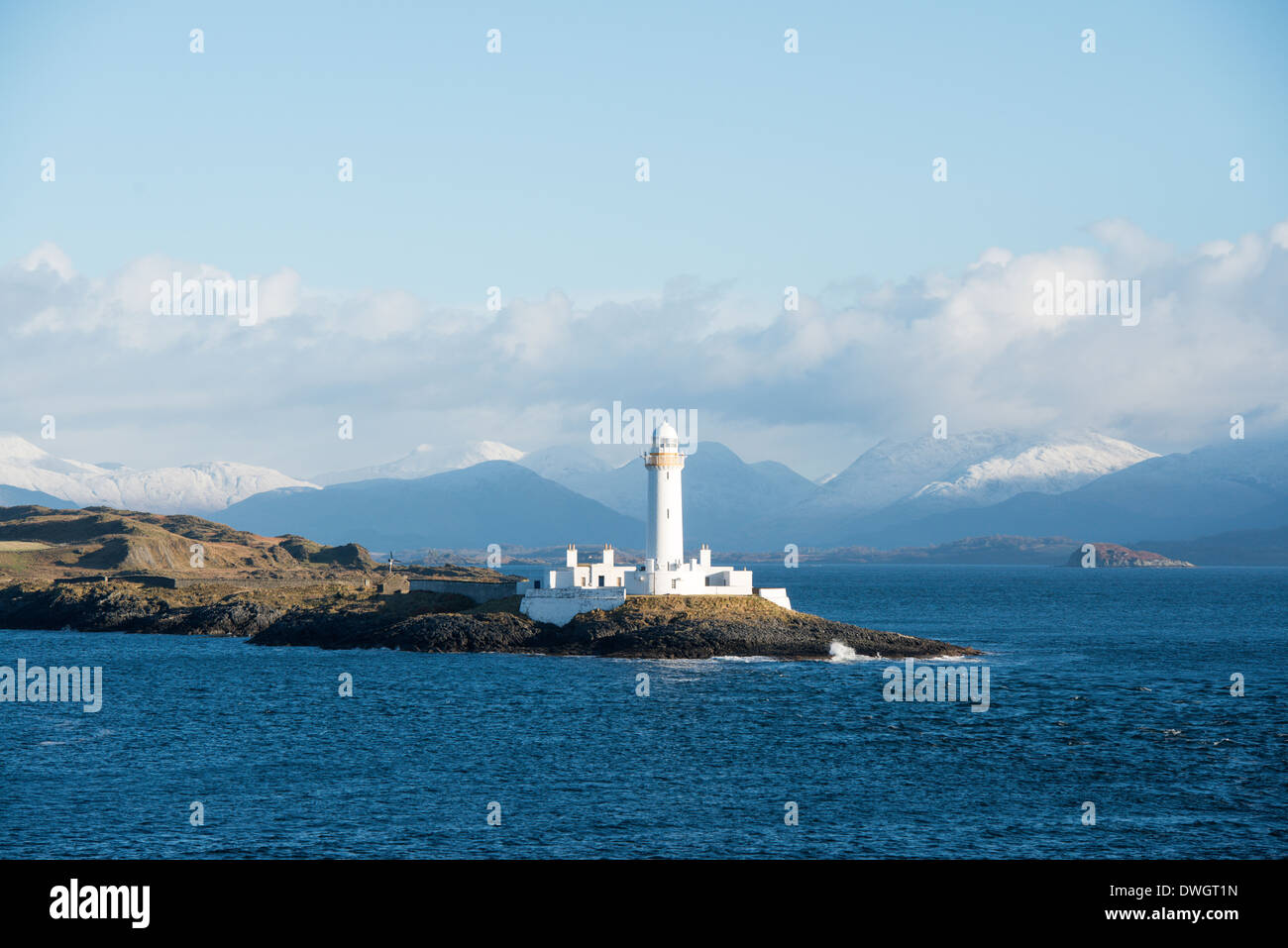 Eilean Musdile islet and lighthouse to the south of Lismore in the Inner Hebrides. Seen from ferry Oban to Mull. - Stock Image