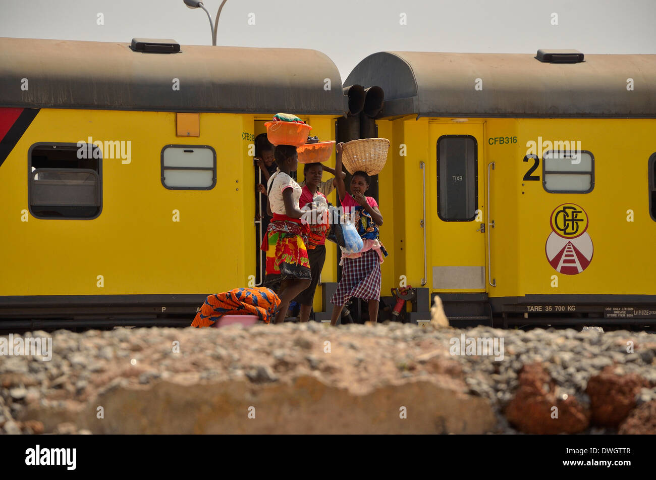 Locals selling wares to train passengers. Angola. Africa. - Stock Image