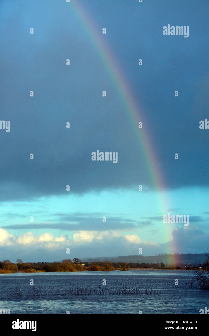 Rainbow over floodwater where the River Derwent burst it's banks due to record rainfall. Old Malton in North Yorkshire, Stock Photo
