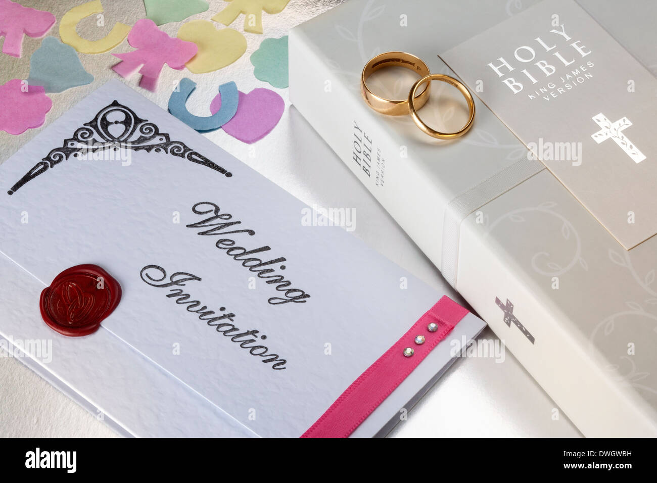 A Wedding Invitation and Holy Bible. - Stock Image