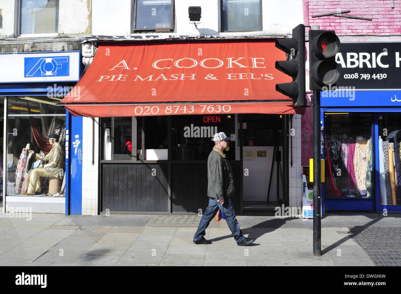 A man walks past Cooke pie and mash shop in Shepherd's, London - Stock Image