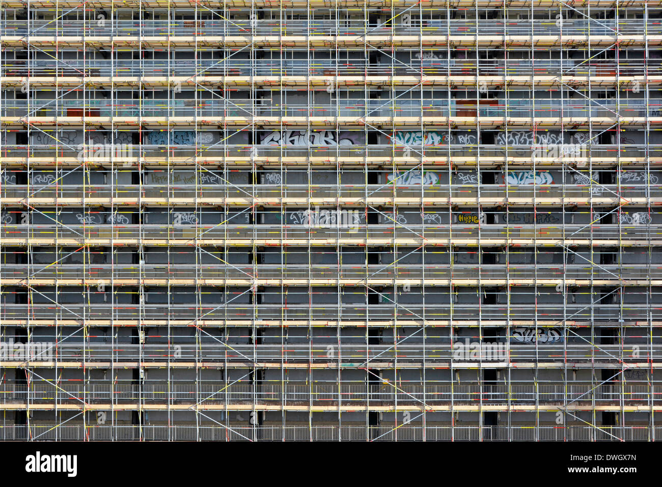 Scaffolding erected around one large empty Heygate Estate high rise social housing blocks preparing for demolition Southwark South London England UK - Stock Image