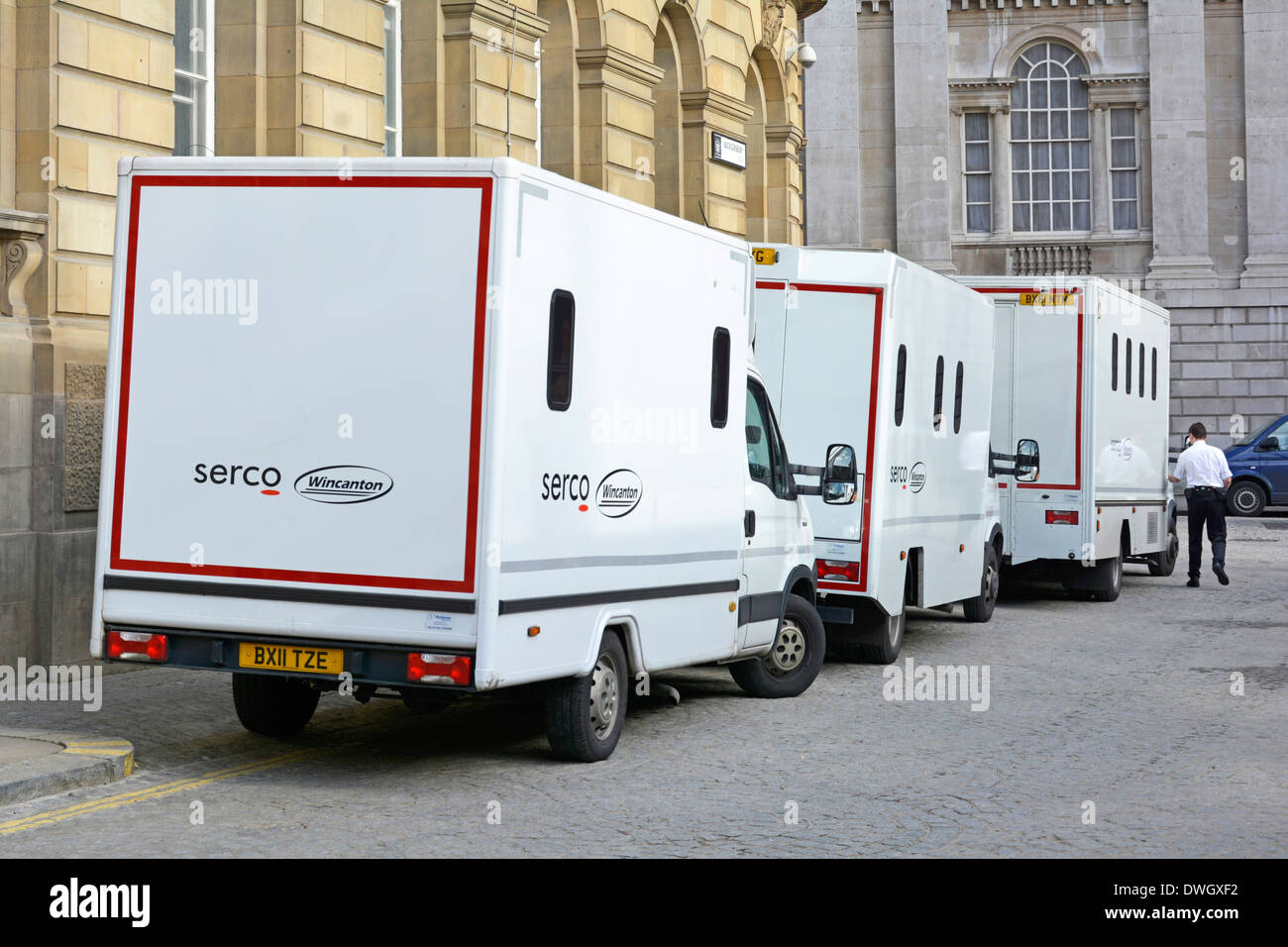 3 joint venture Serco (outsourcing business) & Wincanton prisoner vans parked outside rear of City of London - Stock Image