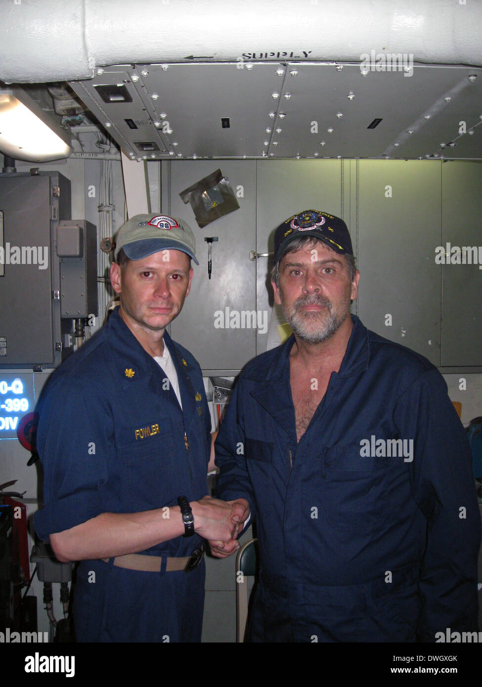 Maersk-Alabama Captain Richard Phillips thanks Lt. Cmdr. David Fowler, executive officer of USS Bainbridge after - Stock Image