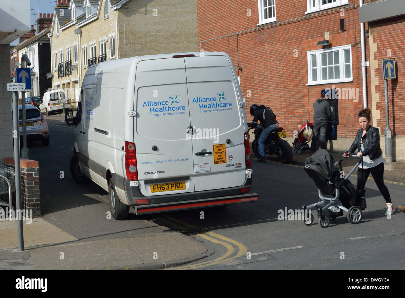 Gorleston-on-Sea, Norfolk, UK. 8th March 2014. Van with 'How's My Driving?' sticker parked on double yellow lines and a disabled parking bay next to a junction where pedestrians are crossing. Gorleston-on-Sea, Norfolk, UK. 8th March 2014 Credit:  Stephen Gostick/Alamy Live News - Stock Image