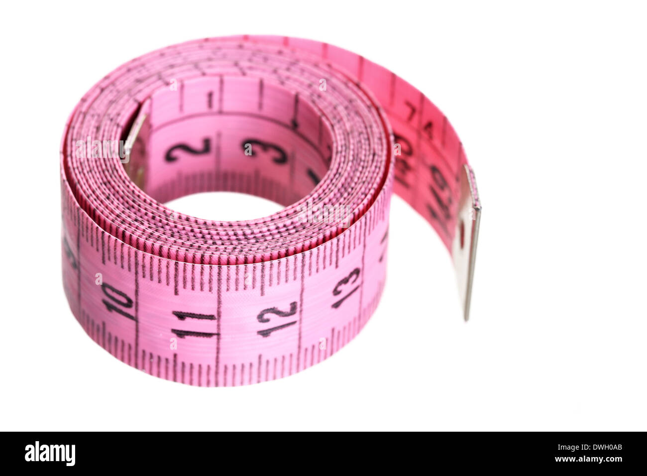 Pink measuring tape isolated over white background - Stock Image