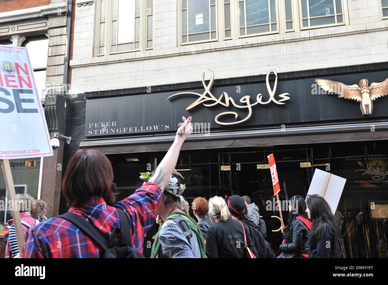 Wardour Street, London, UK. 8th March 2014. The 'Million Women Rise' protest march passes Peter Stringfellows Gentlemans Club on Waedour Street. Credit:  Matthew Chattle/Alamy Live News - Stock Image