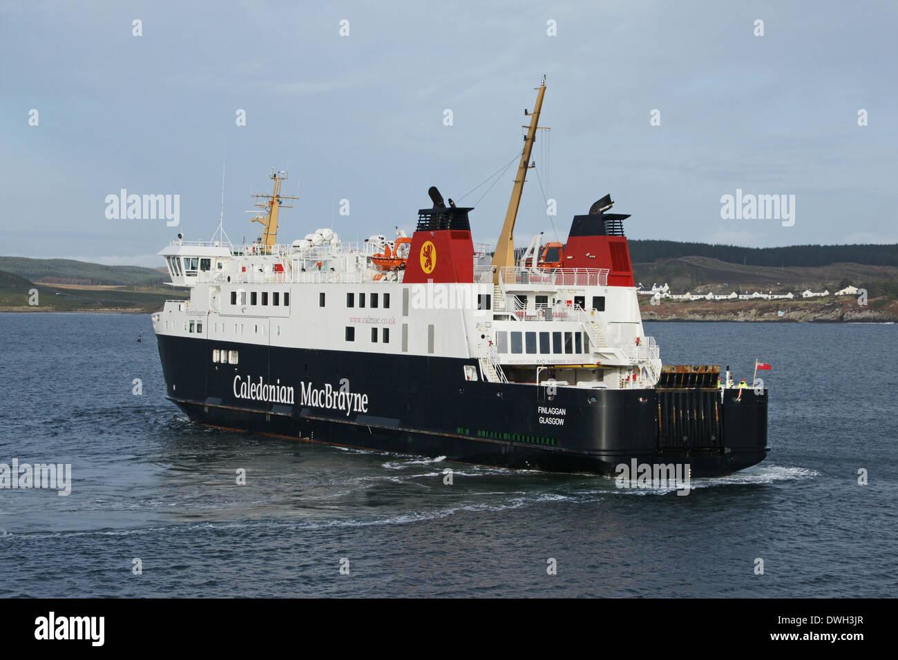 Caledonian MacBrayne car and passenger ferry Finlaggan docking at Port Ellen ferry terminal on Islay Western Isles Stock Photo