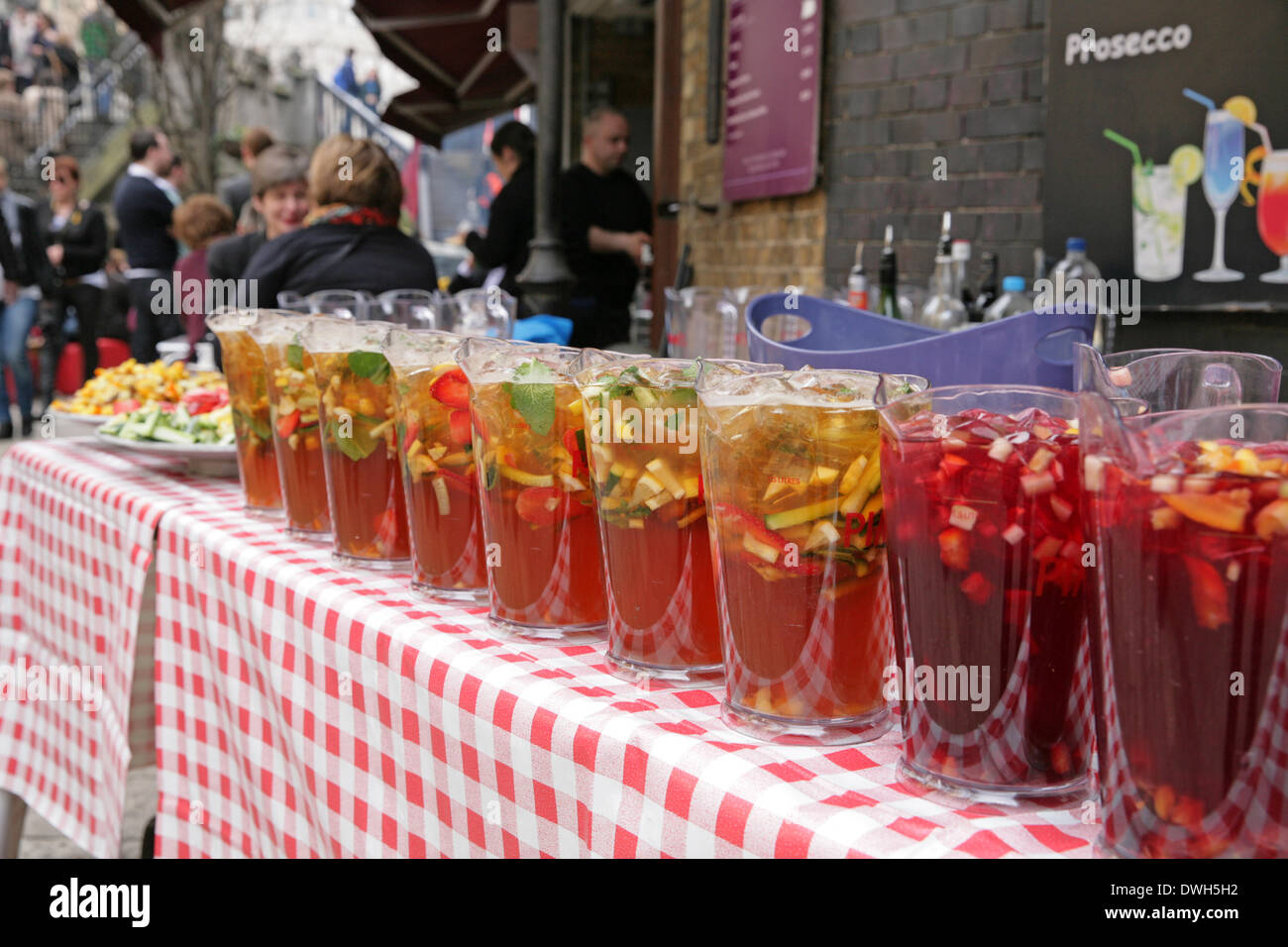 London, UK. 8th March 2014. It was Pimms o'Clock in Borough Market London. Credit:  Keith Larby/Alamy Live News - Stock Image