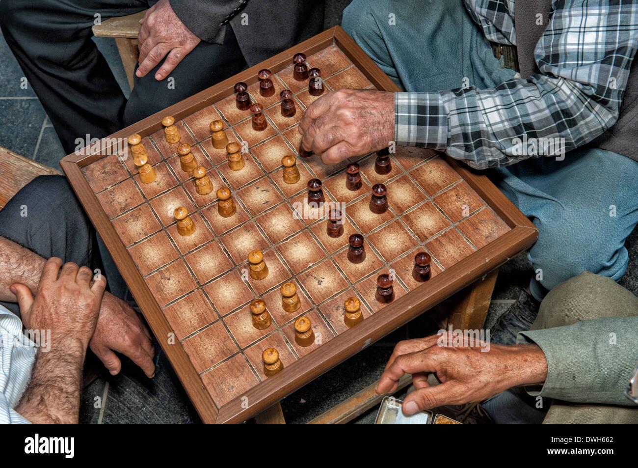 Man playing draughts, Urfa - Stock Image