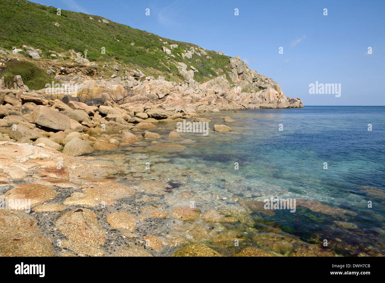 Round boulders cover the cove bed on a sunny summer day at Penberth Cove, Cornwall, England Stock Photo