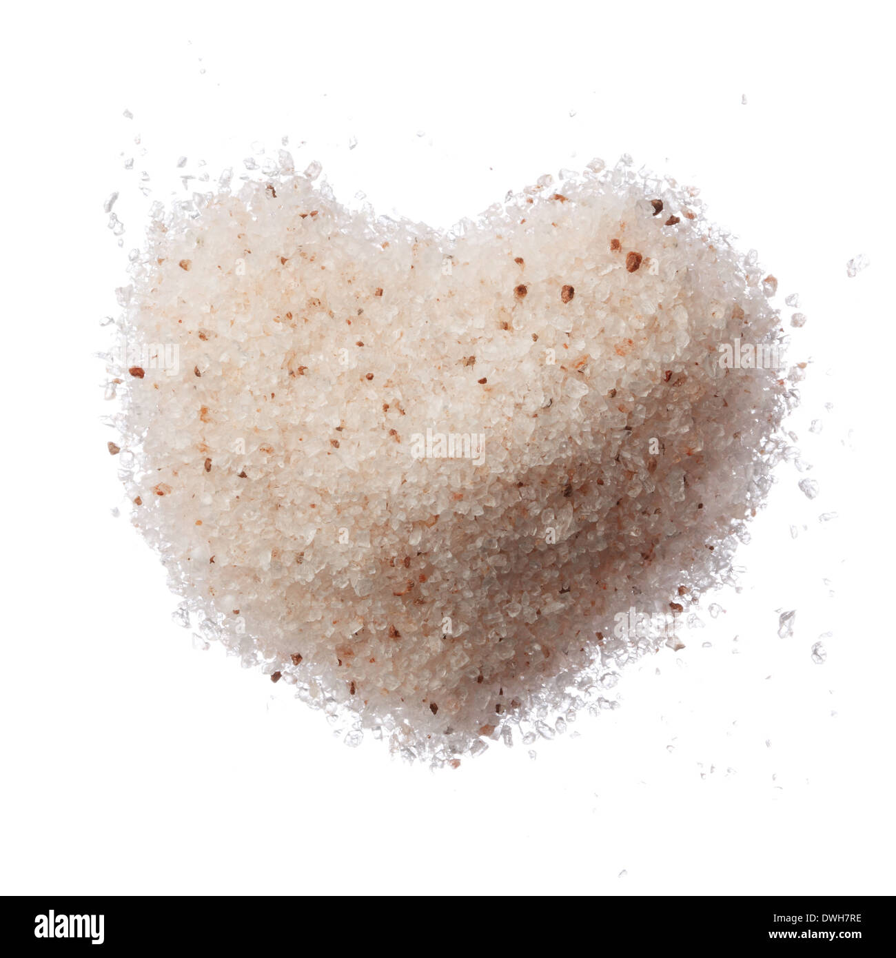 Himalayan pink salt heart isolated on white top view - Stock Image