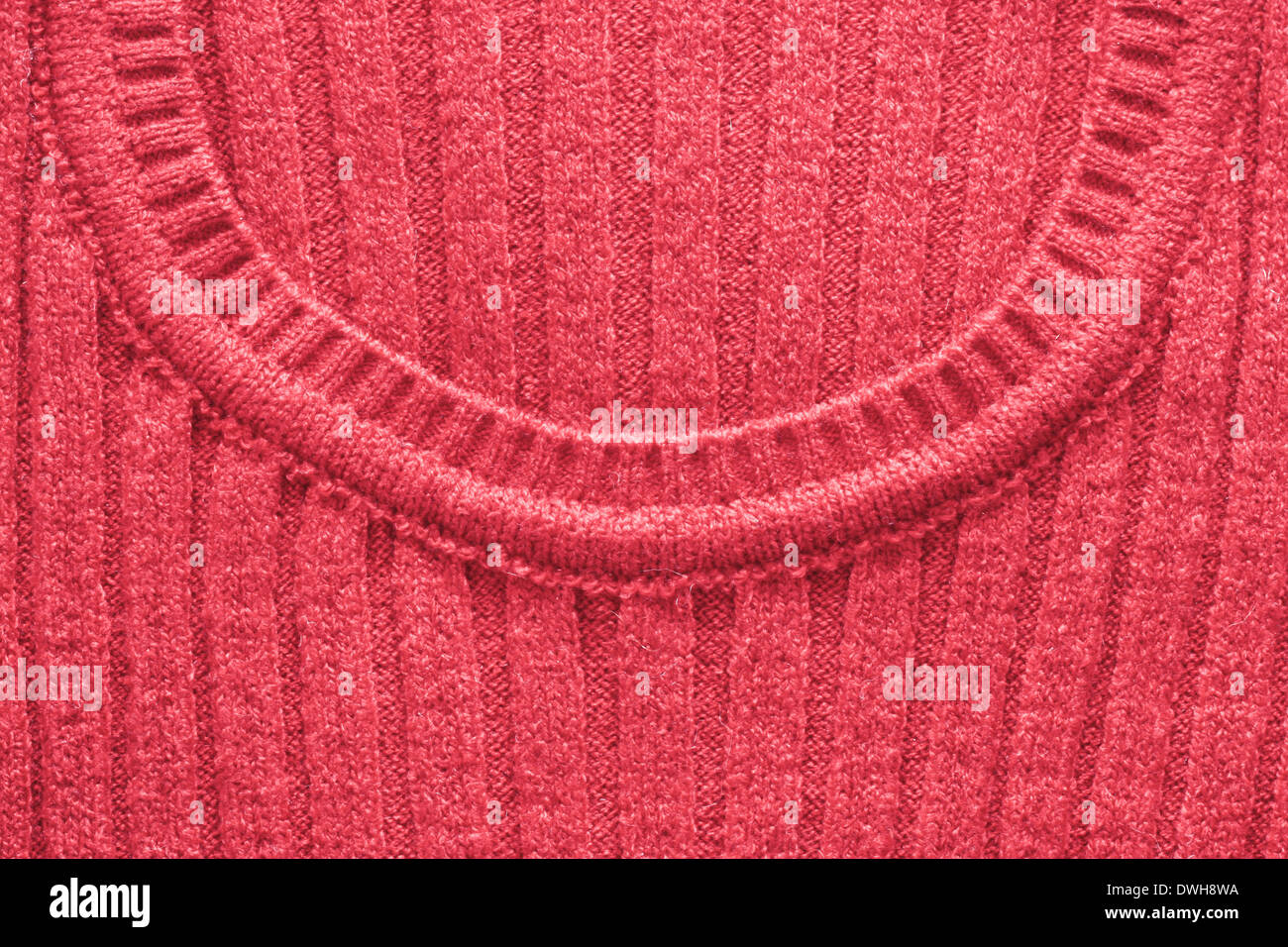 Neck line of a red wool women's jumper - Stock Image
