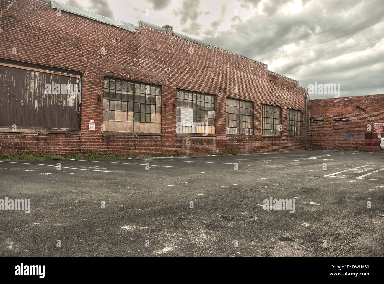 HDR image of a parking lot in an urban area. This image makes a great background for composites. - Stock Image