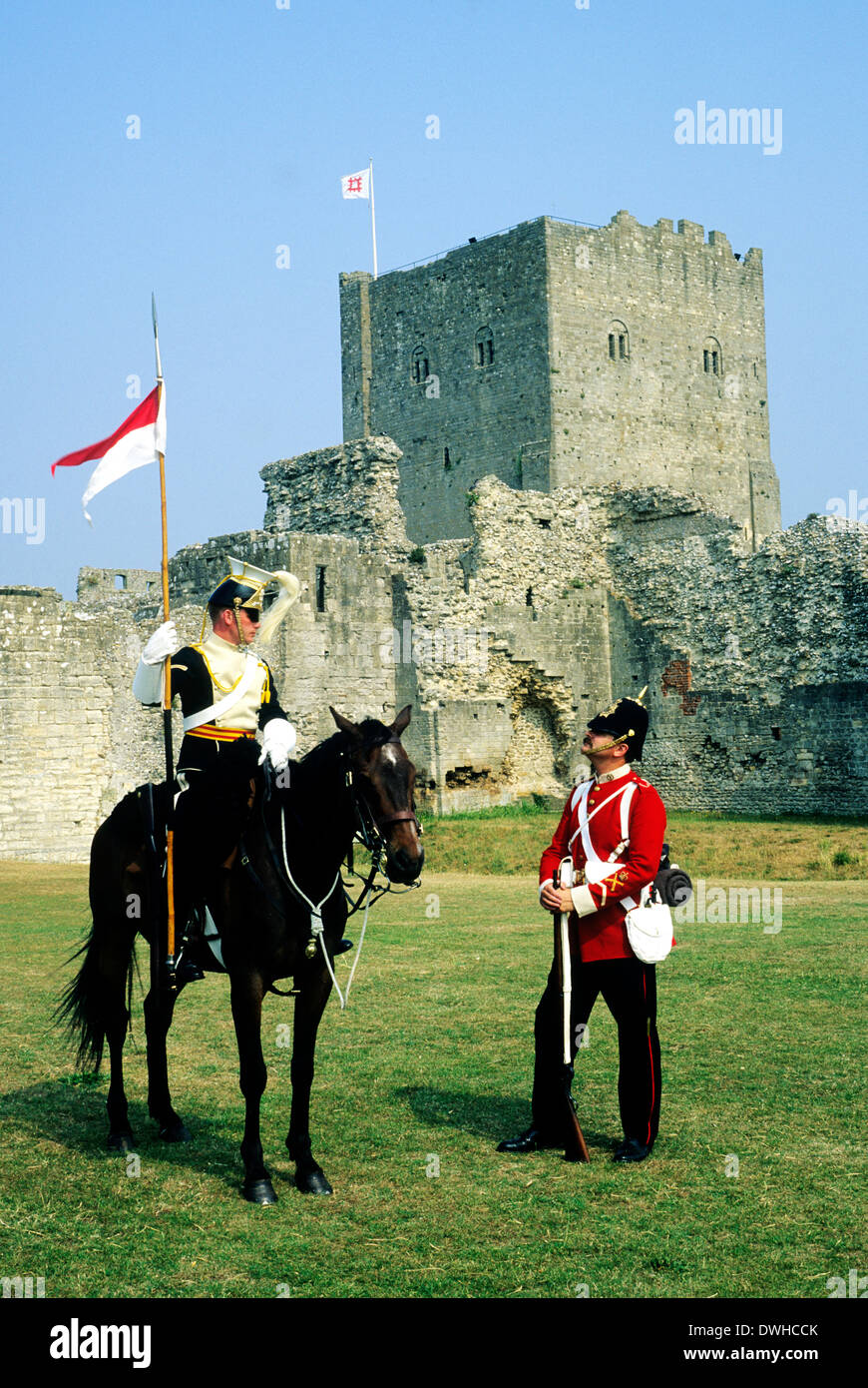 Portchester Castle, Hampshire, late 19th century British military, 17th Lancers and 57th Middlesex Regiment, historical re-enactment soldier soldiers cavalry cavalryman England UK - Stock Image