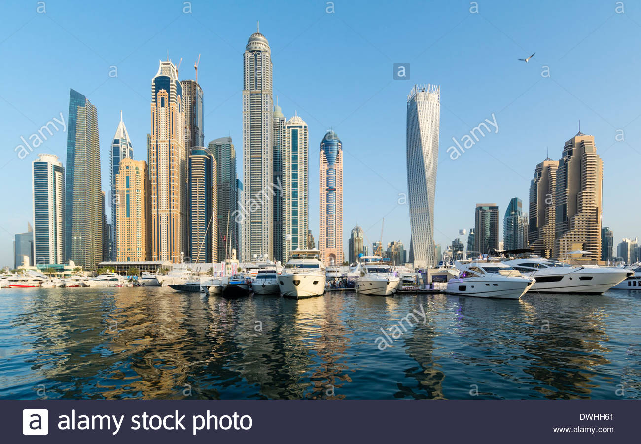 View of skyline of  skyscrapers from yacht club marina during international boat show in Dubai, United Arab Emirates - Stock Image