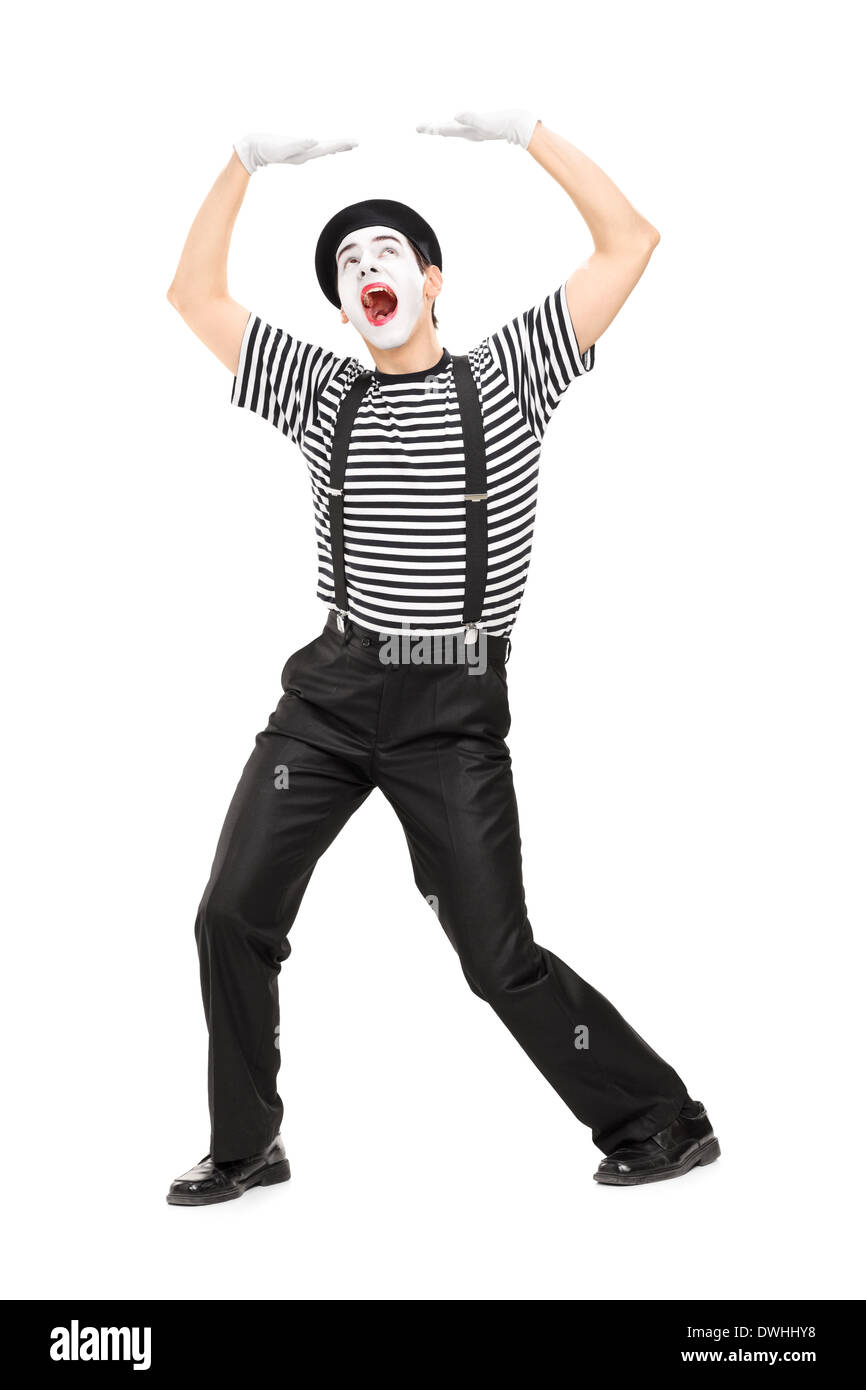 Mime artist simulate carrying something over his head - Stock Image