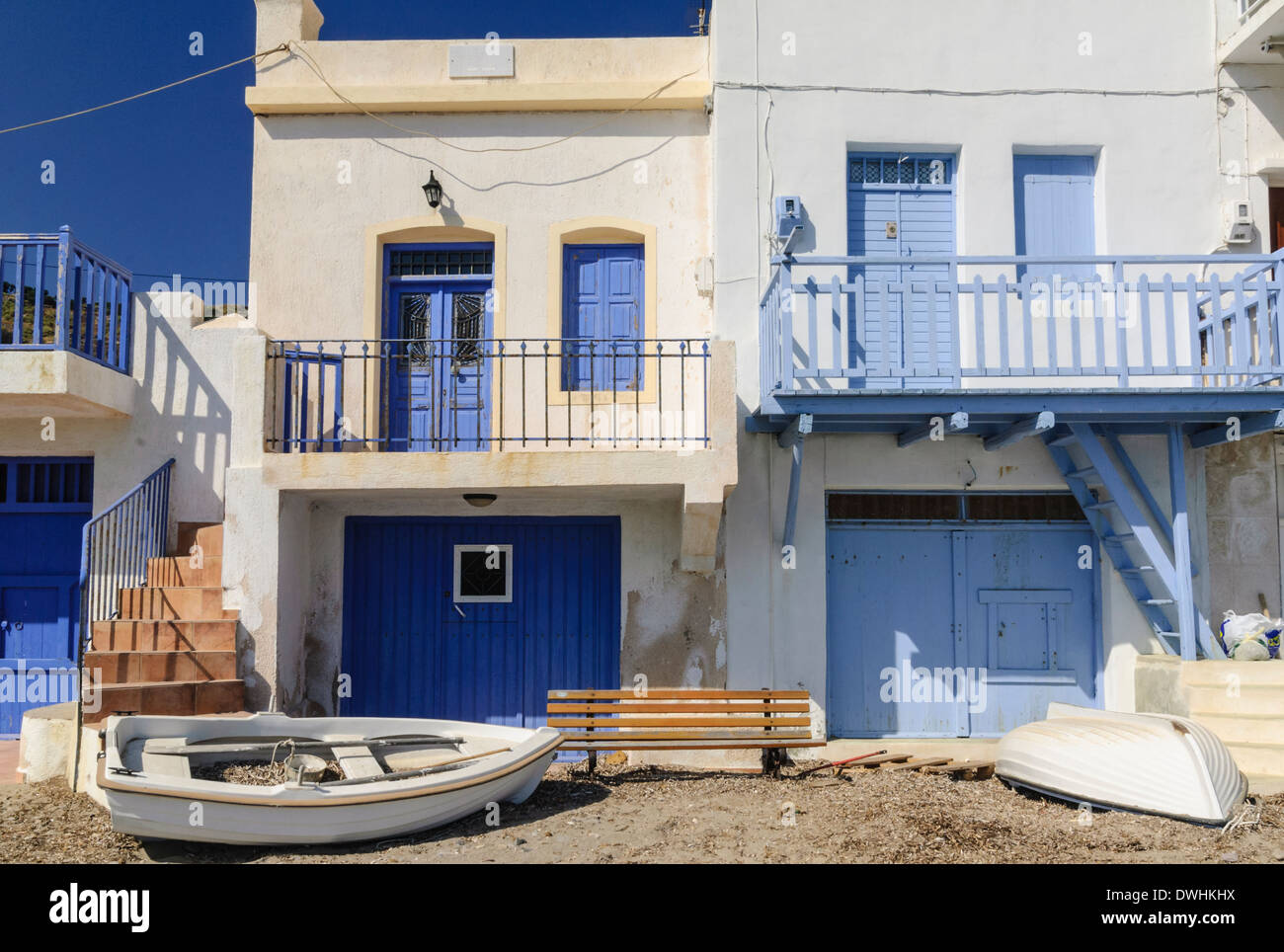 Syrmata, fishermen's houses in the tiny seaside village of Klima on Milos Island, Cyclades, Greece Stock Photo