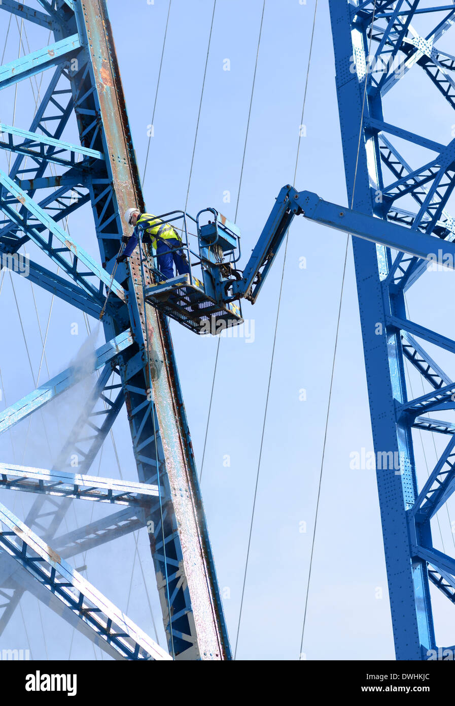 HP water washing of a steel bridge at height prior to painting - Stock Image