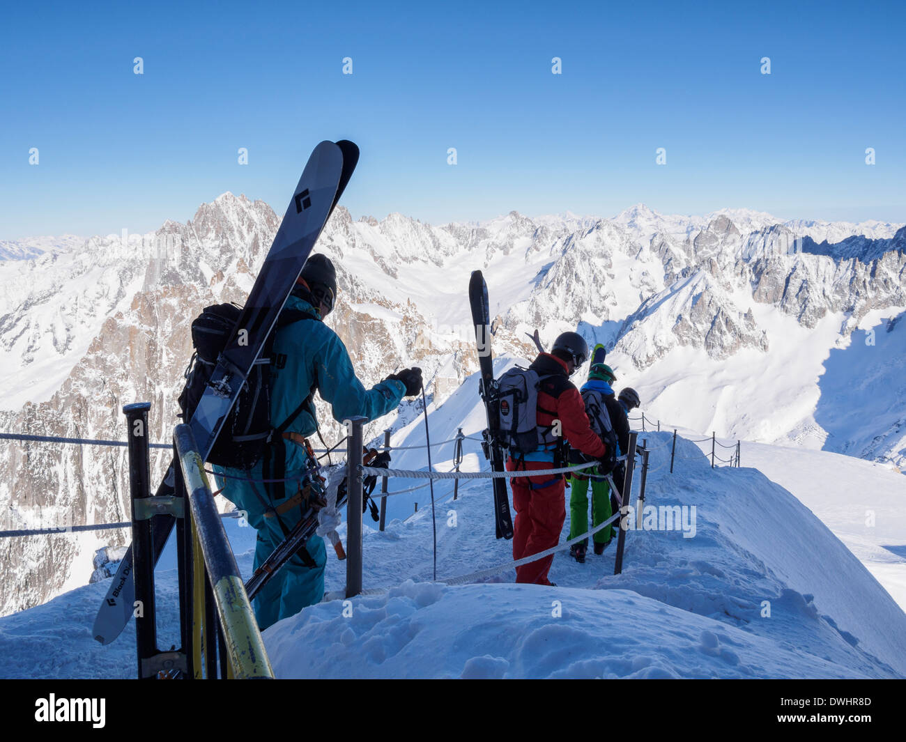 Skiers descending roped path route on arête to ski Vallee Blanche from Aiguille du Midi Chamonix-Mont-Blanc Rhone-Alpes France - Stock Image
