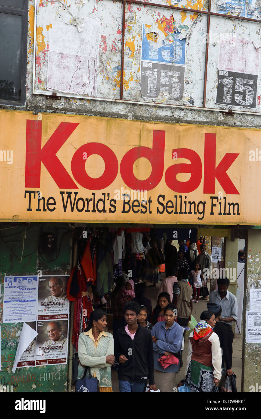 The main street of Nuwara Eliya in 2014, with an old advertising sign for Kodak film, a bygone era in the digital age - Stock Image
