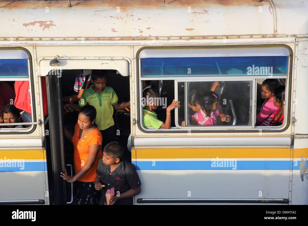 Schoolchildren on bus in Galle Fort, Sri Lanka - Stock Image