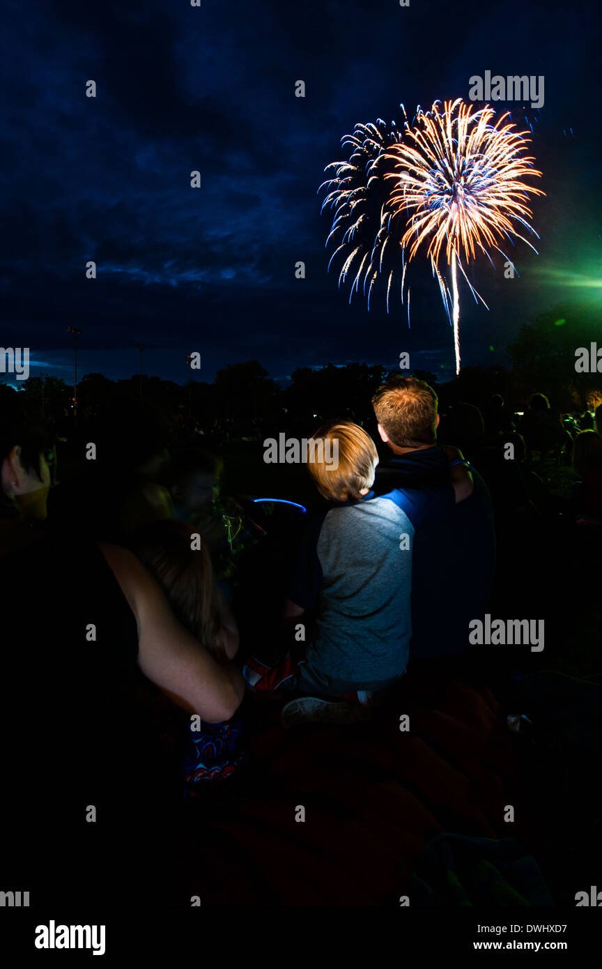 People watch fireworks display in Lakewood, OH. - Stock Image