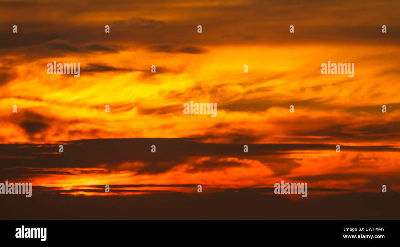 Fiery sunset over Cardigan Bay - Stock Image