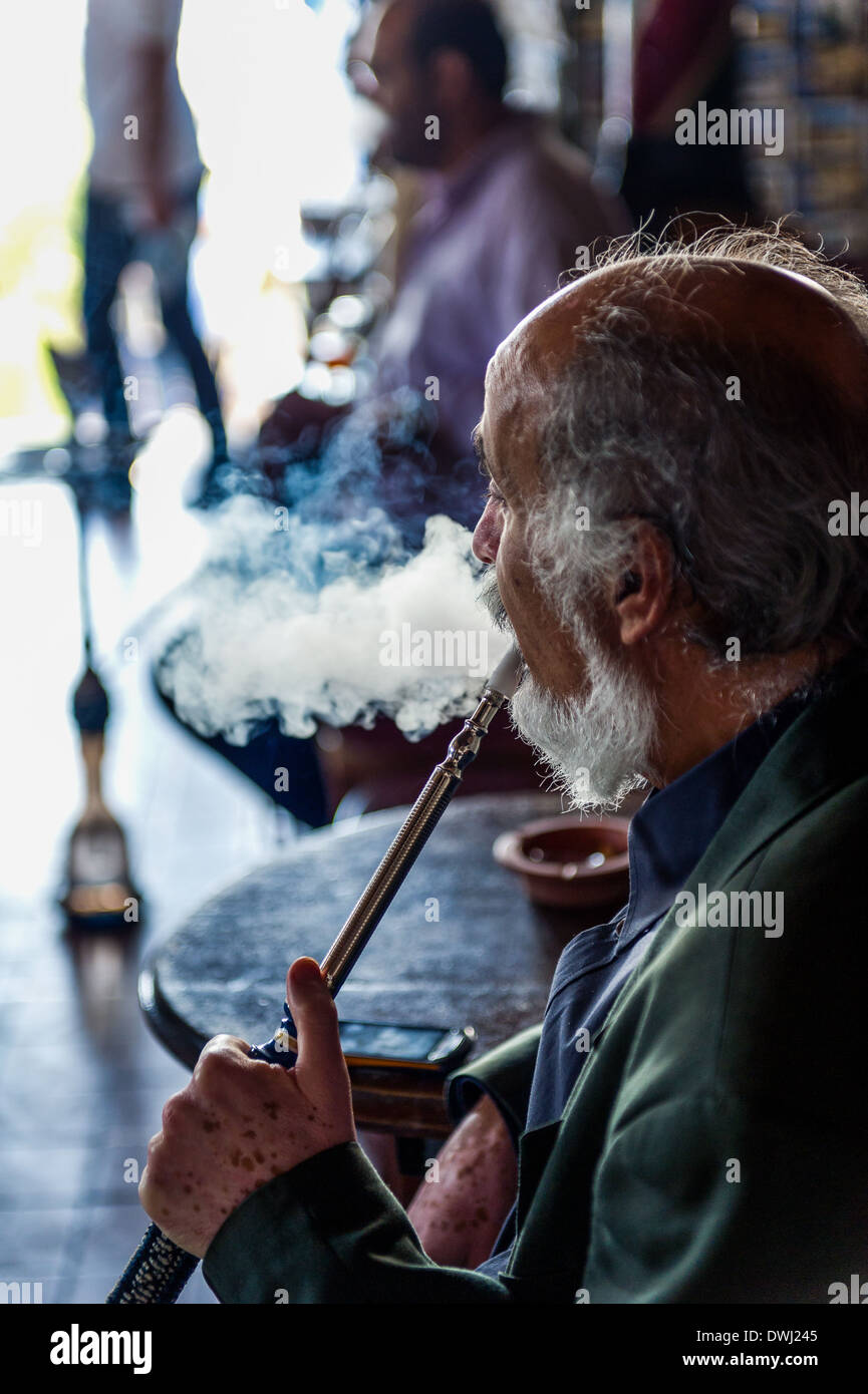 North Africa, Tunisia, Sidi Bou Said. Smoker of hookah at the famous 'cafe of the Nattes'. - Stock Image