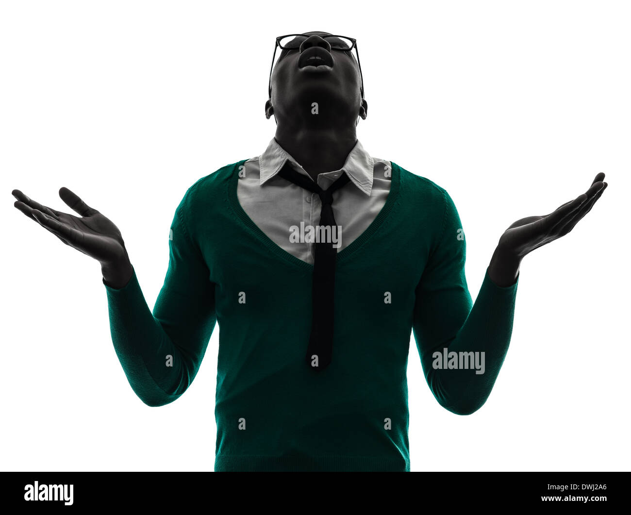 one african black man looking up complaigning in silhouette studio on white background - Stock Image