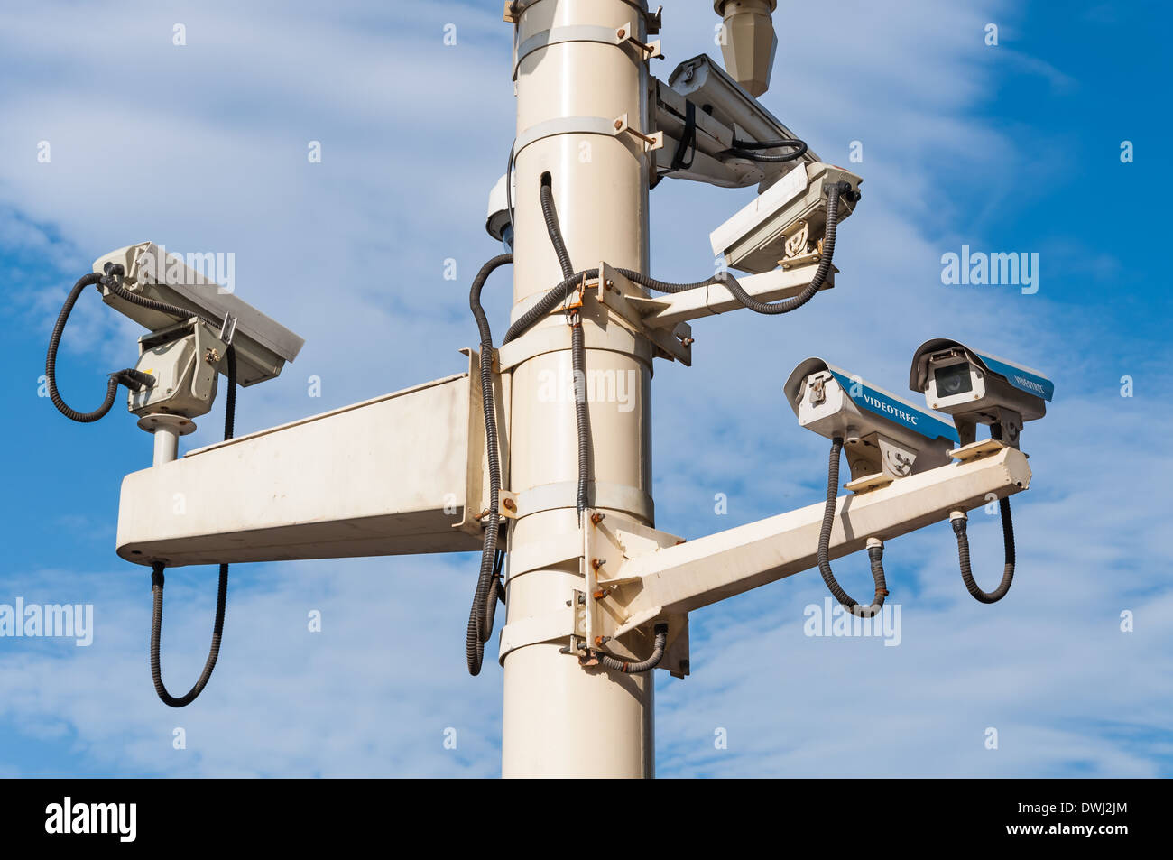 A system of security cameras keep an eye on the public. - Stock Image