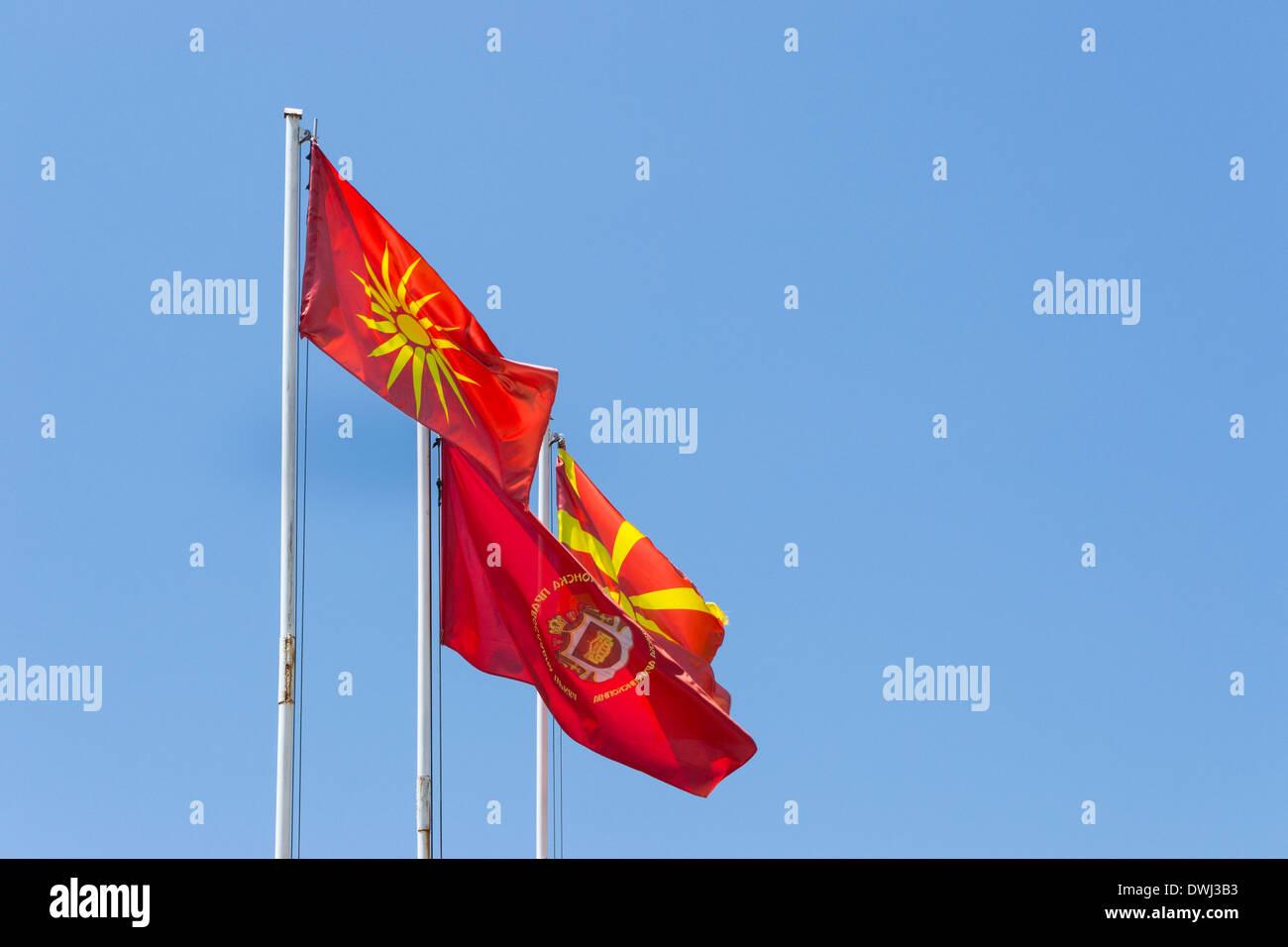 Macedonian flags: old Vergina Flag, Macedonian Orthodox Church flag, new Macedonian flag - Stock Image