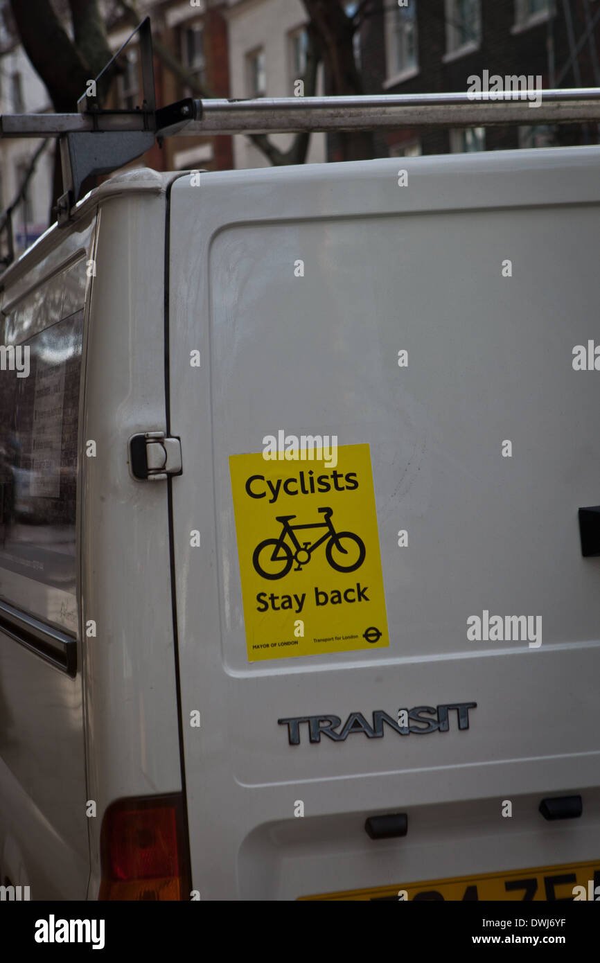 White Van with a 'Cyclist stay back' sticker on its rear doors Stock Photo