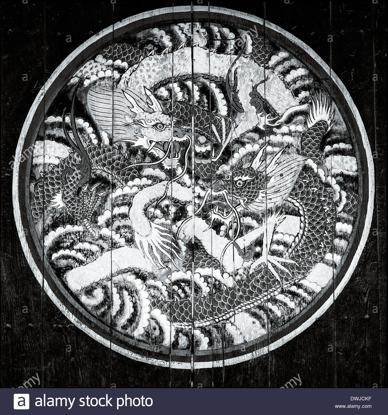 Close up detail of a Buddhist dragon symbol painted on a Buddhist temple, Chungju, South Korea. - Stock Image