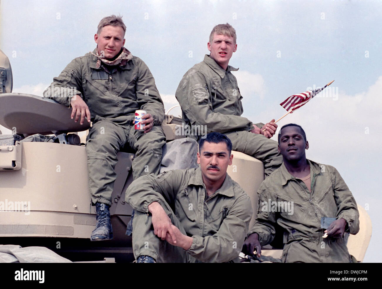 US Army soldiers sit on top of their Bradley Fighting Vehicle after the land battle begun crossing the border into Iraq during the Gulf War February 24, 1991 in Southern Iraq. - Stock Image