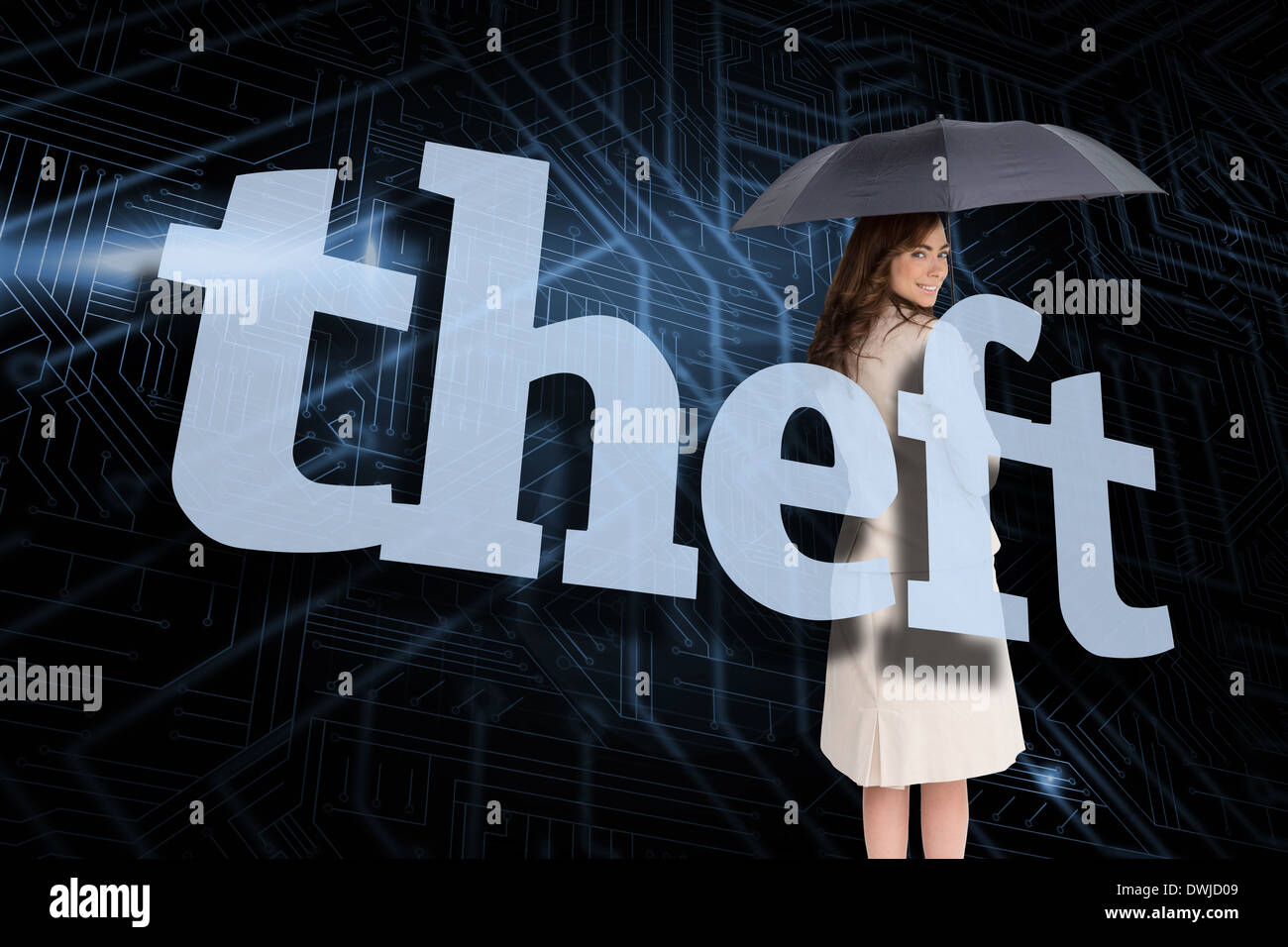 Businesswoman holding umbrella behind the word theft - Stock Image